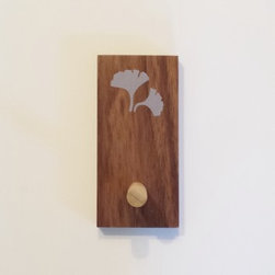 Modern Key Hanger and Coat Hook by MOD-RAK Design - This beautiful and versatile piece works great as a key hanger and coat hook as well as for hanging various other accessories such as jewelry and headphones. Made using reclaimed walnut with a poplar hardwood hooks that is recessed into the wood with a slot for grabbing you key ring. This is the purple ginkgo leaf version and features a low voc water based sealer.