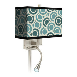 """Giclee Glow - Contemporary Blue and Green Circles LED Reading Light Plug-In Sconce - This giclee shade wall sconce has a clean crisp look and contemporary appeal. It features a giclee printed pattern on high-quality canvas. The angular frame comes in a lustrous brushed steel finish. Installation is easy: just plug it in to any standard wall outlet. It's perfect beside a bed or a reading chair thanks to the energy efficient gooseneck LED reading light. Reading light and main light are controlled separately. This item is custom made-to-order. Brushed nickel finish. Giclee shade. Plug-in style. Brushed nickel finish cord cover included. Takes one 60 watt bulb (not included). Gooseneck light with 12 LED array. 13 1/2"""" high 14"""" wide. Extends 6 1/4"""" from the wall. Gooseneck LED with 10 1/2"""" extension. Backplate is 5"""" wide 9"""" high 1 1/4"""" deep. Shade is 14"""" wide 5"""" deep and 8 1/2"""" high. U.S. Patent # 7347593.  Brushed nickel finish.  Exclusive Blue and Green pattern giclee-printed shade.  Plug-in style.  Brushed nickel finish cord cover included.  Takes one 60 watt bulb (not included).  Gooseneck light with 12 LED array.  13 1/2"""" high 14"""" wide.  Extends 6 1/4"""" from the wall.  Gooseneck LED with 10 1/2"""" extension.  Backplate is 5"""" wide 9"""" high 1 1/4"""" deep.  Shade is 14"""" wide 5"""" deep and 8 1/2"""" high."""