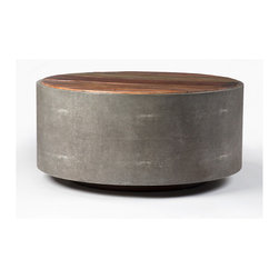 """Four Hands - Crosby Round Coffee Table - You'll want to bang the drum all day with this stylish coffee table. Made with reclaimed and sustainably harvested wood, its rough texture and upbeat lines will thump your bass. Top it with a vase of flowers, a stack of vintage """"Rolling Stone"""" magazines and a much-needed cowbell."""