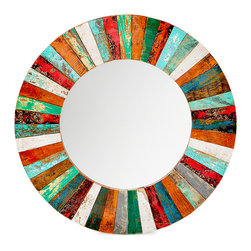 EcoChic Lifestyles - Compass Rose Reclaimed Wood Mirror - Vivacious color comes at you from all directions when you look into the Compass Rose Mirror. The hand-cut wedges of reclaimed wood are carefully pieced together to form the circular frame. Fishing boats that once navigated north, south, east, and west now come to rest on your wall.