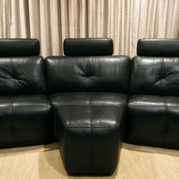 Gillian Residence - Black leather couch with headrests and ottoman