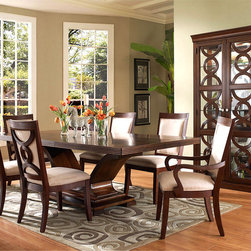 Somerton Home Furnishings - The Dolce - Displaying a beautiful pedestal table, and designer upholstered chairs, the Dolce collection makes for fashionable dining. The matching curio exhibits the same interlocking ring design as the chair backs for a great look. Photo: Somerton Home Furnishings