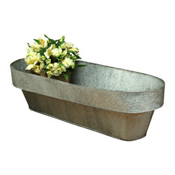 Galvanized Oval Planter - The transitional attraction of weathered metallic patina comes to your garden, porch, or deck with the Galvanized Tin Oval Planter.  Its worn grey color surrounds flowering plants � or river rocks, or a container herb garden � with a folded-back lip of smooth, grainy metal texture that juxtaposes traditional industry with the appeal of nature.  The elongated shape is perfect for rails and walkways.