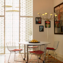Bertoia Side Chairs - Harry Bertoia's delicately industrial Side Chair is among the most recognized achievements of mid-century modern design. Like Saarinen and Mies, Bertoia found sublime grace in an industrial material, elevating it beyond its normal utility into a work of art.