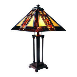 "25"" H Stained Glass Mission Style Southwestern Table Lamp - The Southwestern Collection features a diamond and arrow pattern that runs through the center of each side.  The colors are warm with a cool stripe of blue.  This shade alternates smooth and textured glass.  The base is constructed with four studded column and the rod through the center breaks the straight pattern with a bead medallion."