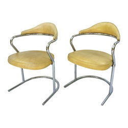 "Used 1970s Chrome Chairs - A Pair - A pair of fabulous 1970s chrome chairs with a light yellow vinyl upholstery.  Not only do these chairs look great but they are comfortable too!  Perfect for dining chairs or at a desk.  The original vinyl upholstery is in very good condition with one scuff mark (pictured).  They are great as is and would be amazing recovered.      Each chair measures 22""L x 22""W x 32""H; seat, 18.5""D."