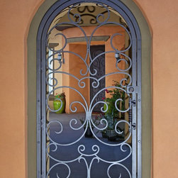 Custom Swirl Iron Gate by First Impression Security Doors - First Impression Security Doors creates beautiful gates for your home.
