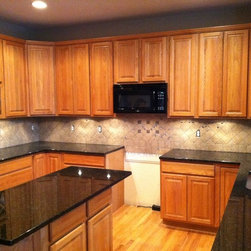 Meek Granite Tops - Kraftmaid Granite countertops: Uba Tuba with Roundover edge.