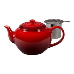 Le Creuset - Le Creuset Large Teapot with Steel Infuser - For a truly memorable cup of tea, whole-leaf loose varieties offer a full spectrum of flavors and infusions. The classic style of this teapot fits into any kitchen, while the stainless steel insert makes it easy to add loose leaves to hot water for steeping and pouring the perfect cup. Its 1-quart capacity is perfect for entertaining family and friends.