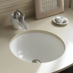 KOHLER - KOHLER K-2349-G9 Camber Undercounter Lavatory in Sandbar - KOHLER K-2349-G9 Camber Undercounter Lavatory in SandbarBring strong, pure design to your bath or powder room with the Camber undercounter lavatory. This circular vitreous china model is without faucet holes; combine with a wall- or counter-mount faucet to complete the lavatory.KOHLER K-2349-G9 Camber Undercounter Lavatory in Sandbar, Features:• Circular shape provides strength and purity in design