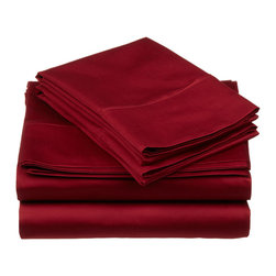 """650 Thread Count Egyptian Cotton California King Burgundy Solid Sheet - Nothing refreshes a mind and body more than a good night sleep. Experience true 100% Egyptian Cotton luxury when you sleep on these 650 Thread Count sheets. An affordable luxury that drapes beautifully on the bed. These 650 thread count sheets of premium long-staple cotton are """"sateen"""" because they are woven to display a lustrous sheen that resembles satin. Set includes: One Flat 110x104, One Fitted 74x84 and, Two Pillowcases 21x42 each."""