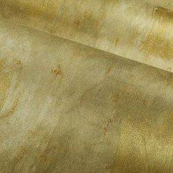 Gold Leaf Fabric in Sauterne - Gold Leaf Fabric in Sauterne is a metallic cotton blend that works well for drapery and other window treatments, upholstery, or bedding and pillows. Made in the USA from a blend of 53% cotton and 47% rayon and treated with a stain repellent finish. Cleaning code: S. Repeat: 25″V 27″H; Width: 54″.
