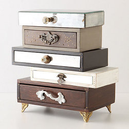 Topsy-Turvy Jewelry Box - This stack of small drawers is a chic way of hiding your jewelry, or even a nail file or lip balm next to your bed.