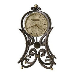 """Howard Miller - Wrought Iron Frame Mantel Clock w Polystone D - A beautiful addition to any home, this uniquely designed mantel clock will add style to your home for many years. Clock features a wrought-iron look design in hardwood and veneer construction, and clock face features aged black and gold crackle background with gold hands that match beautifully. Clock face is covered by glass crystal. * This wrought iron mantel clock is finished in aged iron with antique gold accentsThe dial is cast polystone with cast hour markers and raised outer edge the hands and pendulum are finished in aged iron to match case. Quartz, battery operated movement12""""H x 7 1/4""""W x 4 1/4""""D"""