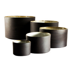Black and White Nesting Bowls – Full Quintet - These simply beautiful earthenware nesting bowls are elegant and unusual.  They are each slip-cast by hand in black clay and the outside is left unglazed, offering a unique tactile and visual contrast between the matte exterior and the light glossy white interior.  Fired at stoneware temperature, they are food-safe, dishwasher and microwave safe. The nature of the clay and Diana's technique make each item distinctly unique, giving each a personality of it's own. Handmade in South Africa.