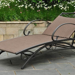 International Caravan - Chaise Lounge (Antique Brown) - Finish: Antique BrownWater resistant. UV light fading protection. Equipped with wheels for easy transportation. Five positions for various comfort zones. Powder coated frame. Made from wicker resin and steel frame. Assembly required. 73 in. W x 26 in. D x 27 in. H (54 lbs.)The Valencia outdoor wicker resin chaise lounge is a best seller.