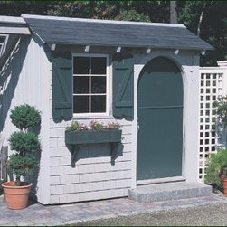 6' x 8' Shingle Front Building - Shown here is a Small Building with an arched Dutch door, custom stain, and Lattice fence on one side.