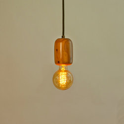 The Cedar Lamp - Smooth-finish Eastern Cedar pendant light. Adds warmth to any kind of environment, modern or farmhouse. Comes with light bulb and cord of your choice (dark olive, brown, red or black).
