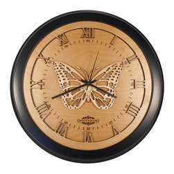 Design & Board, Inc. - Butterfly Wall Clock - Based on the majestic Monarch butterfly this design captures the beauty in every detail. The Butterfly Clock offered only by Design & Board is created, crafted and assembled in the U.S..  All our clocks are individually engraved, precision cut and carefully hand assembled. Each piece is made with multiple layers of natural Birch wood and finished with a durable clear lacquer finish to ensure quality.