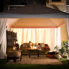 Eclectic Patio by Phoenix Tent and Awning Company