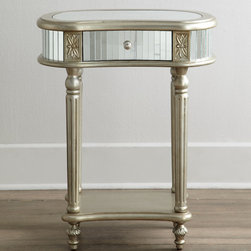"""Melrose"" Mirrored Side Table - Pure glamour, this diminutive side table features sparkling mirrors adorning the shaped top, apron, and drawer front. A shimmery finish, cartouches, slim reeded posts, and a petite decorative foot increase the feminine appeal."