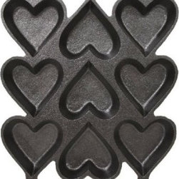 Cast Iron Heart-Shaped Cake Pan - The possibilities are endless with this heart-shaped cast iron pan. Mini cakes, brownies, muffins or even cornbread can now add the perfect touch to your Valentine's Day meal.