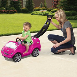 """Little Tikes - Little Tikes Mobile Car Riding Push Toy - Pink - 620201 - Shop for Tricycles and Riding Toys from Hayneedle.com! There aren't many chances to ride around in a pink convertible without being called """"Barbie """" so let your little girl have the chance now with the Little Tikes Mobile Riding Toy - Girls Version. This rugged plastic sports car features quiet-ride tires an integrated seatbelt and cup holders. Unlike most sports cars you might actually be able to fit something in the storage area located under the front hood. The folding push-handle can be locked into position to make for easy transport or you can extend it to take your little one out for some parent-pushed fun. There's no better way to enjoy the sunshine than with a pink convertible so get out there with your little one and let the wind blow through your hair. This riding toy has a weight limit of 50 lbs and is recommended for children from 18 months to 4 years.About Little TikesFounded in 1970 the Little Tikes Company is a multi-national manufacturer and marketer of high-quality innovative children's products. They manufacture a wide variety of product categories for young children including infant toys popular sports play trucks ride-on toys sandboxes activity gyms and climbers slides pre-school development role-play toys creative arts and juvenile furniture. Their products are known for providing durable imaginative and active fun.In November of 2006 Little Tikes became a part of MGA Entertainment. MGA Entertainment is a leader in the revolution of family entertainment. Little Tikes services the United States from its headquarters and manufacturing facility in Hudson Ohio but also operates several manufacturing and distribution centers in Europe and Asia."""