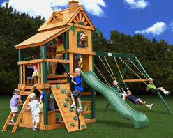 Gorilla Playsets - Gorilla Playsets Laredo Wood Swing Set Multicolor - 01-1027 - Shop for Swings Slides and Gyms from Hayneedle.com! There s no room for boredom in the Gorilla Playsets Laredo Wood Swing Set s house. Crafted with durable Timber Shield posts and cedar wood in a playhouse-inspired design this backyard set boasts a green Wiki Wave slide an enclosed Extreme Tube slide two classic swings and a belt swing with safety-coated chains to protect little hands and a bevy of built-in features. Included are a tic-tac-toe panel chalkboard kit jumbo play binoculars a play telephone a play telescope a sandbox a toy box with a removable top and a picnic table. Also includes manufacturer s 10-year lumber and 1-year accessories warranties; for information call 800-882-0272. About Gorilla PlaysetsSince 1992 Gorilla Playsets has been designing and selling ready-to-assemble playsets. With a reputation for providing excellent customer service Gorilla Playsets conveniently provides customers with affordable playsets including quality wood components sturdy playset accessories all necessary hardware and clear instructions. Gorilla Playsets always keeps safety in mind while creating inventive durable products that provide children with myriad possibilities for fun and play.