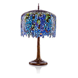 "30"" H Tiffany Inspired Grand Wisteria Table Lamp w/Tree Trunk Base - This award-winning, breathtaking design is modeled after the famous Wisteria line by Louis C. Tiffany. This dramatic lamp makes a stunning impression in any room, or as a fabulous statement in your entry way. This majestic stained glass lamp will bring delicate light into your home, with hues of green and purple.e"