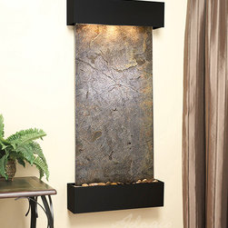 Lightweight Slate Wall Water Features -  The Cascade Springs LW Green Slate - At just $1,449 with its hand chiseled green, red, black, or rajah LW Slate, the Cascade Springs wall fountain is the perfect way to distinguish your space from the rest. This interior or exterior wall water wall displays a rustic finish and illuminating light above, making the Cascade Springs wall mounted water fountain an earthy & delightful piece that will leave your guests or clients in awe. Become the envy or your entire neighborhood with this amazing water feature. The Cascade Springs indoor wall fountain is hand crafted to perfection this piece is available in two types of LW Slate, with three finish options and two corner styles. The Cascade Springs wall fountain is the perfect size water feature for your home, not too large and not too small, this water fountain will hang beautifully from any wall.
