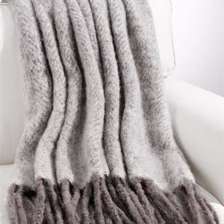 Herringbone Throw - Here's a throw for the man of the house.  This handmade throw is designed in a herringbone design, reminiscent of a beautiful herringbone suit but all soft and fuzzy.  It would look great tossed across a leather sofa in a study or library.