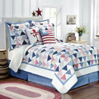Pem America  Inc. - Triangle Stripe Quilt - Celebrate America with this hand-pieced cotton quilt featuring postage stamp triangles in multiple shades of red, blue, and beige on a white ground reminiscent of the American flag.