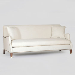 Lincoln Sofa - This gracious sofa echoes a classic European antique style with it's high back and bench-seat cushion. It's the intricate details that make this piece- with it's exposed wooden legs and mixture of straight lines and gentle curves.