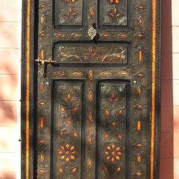 Moroccan Decor - Moroccan tradition states that a beautiful home is known by its front door. This heavy, hand-carved Moorish door with camel bone and carved metal accents will make the perfect statement.