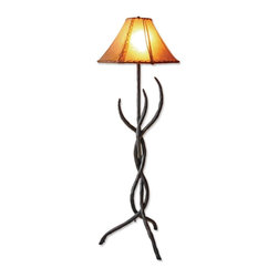 Mathews & Company - Wrought Iron Woodland Floor Lamp - The rustic twisted wrought iron base of the Woodland Floor Lamp is reminiscent of the outdoors. The talented artists from Matthews and Company have created a lamp that will bring an attractive statement to any room. The unique hand stitched shade adds to the outdoorsy feel of this lamp. Created as part of the Woodland collection, this lamp would also look stunning with other pieces from this handcrafted set. Available in four finishes. Pictured in Rawhide shade and Black finish.