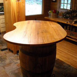 Jack Daniels Barrell table top - Irregular shape Bar top for a jack Daniels whiskey barrel.  Made with reclaimed barn wood from the north Georgia area.
