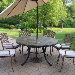 Oakland Living - Stone Art 9-Pc Aluminum Patio Dining Set - Includes table, six arm chairs with cushions, tilting umbrella and umbrella stand. Fade, chip and crack resistant. Solid and sturdy yet trendy designs. Brass hardware. Warranty: One year limited. Made from natural stone and rust free cast aluminum. Hardened powder coat finish in antique bronze. Minimal assembly required. Table: 54 in. Dia. x 29 in. H. Dining chair: 23 in. W x 22 in. D x 35.5 in. H (23 lbs.). Umbrella: 108 in. L x 108 in. W x 100 in. H (45 lbs.)Our stone art dining sets will be a beautiful addition to your patio, balcony or outdoor entertainment area. Stone art dining sets are perfect for any small space or to accent a larger space. The Oakland Stone Art Collection combines natural stone and modern designs giving you a rich addition to any outdoor setting.