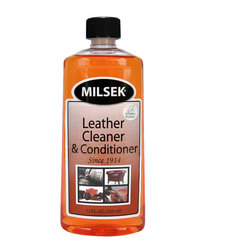 Milsek Furniture Polish - Milsek Leather Cleaner & Conditioner with Real Mandarin Orange Oil 12 oz. - Milsek Leather Cleaner and Conditioner's patented technology is strong enough to effectively clean dirt, remove stubborn leather stains from your furniture that were caused by pets or spills by children, but gentle enough to condition your leather furniture as well. Milsek's natural orange leather cleaner and conditioner moisturizes leather and moisturizes vinyl, which prevents drying, cracking, and the appearance of fine scratches. All that's left behind is the ultimate shine and fresh scent of mandarin orange. Milsek Leather Cleaner and Conditioner do not contain any harmful wax, silicones, or soap residue that would dull or discolor leather. Quite the contrary, once your leather sofa, car seats, or office chairs are cleaned, conditioned, and protected with Milsek. Milsek Leather Cleaner and Conditioner can also be used on leather jackets, leather coats, leather purses, leather boots, leather shoes, leather accessories, horse tack, horse saddles and auto interiors. Milsek Leather Cleaner and Conditioner can even be used for removing ink from leather or to remove pet stains. Milsek for Leather is both a great leather cleaner AND leather conditioner. Made in the USA. DIRECTIONS:  First, use a soft rag or micro-fiber cloth to dust the surface, then apply Milsek Leather Cleaner and Conditioner to a wet cloth or sponge and wipe clean. Using Milsek ensures your leather remains as soft, supple, and shiny as the day you bought it. Allow to dry for at least 10 minutes. Tip: Remember, when removing spots from leather, test Milsek on an out-of-the-way spot first. Dip a cotton swab directly into Milsek Leather Cleaner and Conditioner and rub the stain. Milsek works great for removing ink spots too! MILSEK Leather and Conditioner - 12 oz