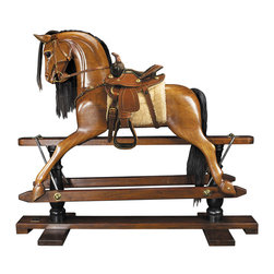 "Inviting Home - Victorian Rocking Horse (Western Saddle) - Victorian rocking horse with western saddle 56"" x 18-3/8"" x 47-1/2"" Younger sons born into nobility or the gentry were often sent to serve at the Royal Court as pages of honor. Part of their education was learning tournament jousting. The master-at-arms used wooden horses mounted on swings to teach skills with sword and lance. This wooden horse evolved over time into the classic rocking horse. No upper class children's playroom was without one. Some were mounted on oval wood rockers others on a 'safety' stand where steel swings allowed for greater movement on a stationary base. Our iconic rocking horse is a full-sized reproduction of originals dating back to the 19th C. Victorian rocking horse is hand carved in top quality mahogany. Hand made saddle and tack of real bridle leather. The expert skills of wood carvers cabinetmakers and saddlers are evident. Hand finished in a warm and glowing French-style varnish slightly distressed to make it look somewhat aged. A timeless treasure and a dream-toy for both boys and girls. Imagine its value in 50 or 100 years!"