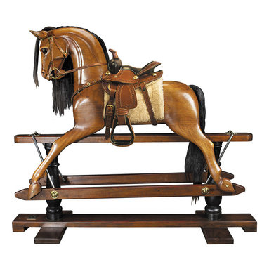 """Inviting Home - Victorian Rocking Horse (Western Saddle) - Victorian rocking horse with western saddle 56"""" x 18-3/8"""" x 47-1/2"""" Younger sons born into nobility or the gentry were often sent to serve at the Royal Court as pages of honor. Part of their education was learning tournament jousting. The master-at-arms used wooden horses mounted on swings to teach skills with sword and lance. This wooden horse evolved over time into the classic rocking horse. No upper class children's playroom was without one. Some were mounted on oval wood rockers others on a 'safety' stand where steel swings allowed for greater movement on a stationary base. Our iconic rocking horse is a full-sized reproduction of originals dating back to the 19th C. Victorian rocking horse is hand carved in top quality mahogany. Hand made saddle and tack of real bridle leather. The expert skills of wood carvers cabinetmakers and saddlers are evident. Hand finished in a warm and glowing French-style varnish slightly distressed to make it look somewhat aged. A timeless treasure and a dream-toy for both boys and girls. Imagine its value in 50 or 100 years!"""