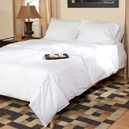 Belle Epoque Down Comforter - Light Weight - Perfect for warmer climates and summer nights, the Belle Epoque Cirrus Down Comforter - Light Weight is also the ideal comforter for hot sleepers in general. This lightweight, thin comforter harnesses the temperature-modulating properties of down and feathers to keep you cool so you can rest peacefully.With a cover made from soft 100% cotton, this comforter is stuffed with a blend of white goose down and feathers with a fill power of over 400. The baffled box-stitch construction uses an inner wall of fabric to let the fill loft to achieve its maximum capacity, while the quilted pattern keeps the stuffing evenly distributed throughout the comforter. Extra-large squares provide a simple, clean look that will open up small bedrooms. This comforter is conveniently machine-washable and is covered by a three-year limited warranty.Comforter Dimensions:Twin: 66 x 88 inchesFull/Queen: 88 x 88 inchesKing: 104 x 88 inchesAbout CGG Home FashionsWhether you are shopping at Bloomingdale's or relaxing at a premier resort, you are sure to find and appreciate CGG Home Fashions products. For over 20 years, the company has been offering a broad selection of luxury linens, high thread count sheets, duvet covers, pillows, down and synthetic comforters, drapes, and table linens. CGG's acclaimed Belle Epoque collection is the epitome of elegance, with styles ranging from traditional to contemporary. With offices and a warehouse in Yonkers, New York, and a showroom on New York's Fifth Avenue, CGG is at the epicenter of textile design and innovation.