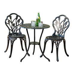 Great Deal Furniture - New England Cast Aluminum Bistro Set - Easy chairs. This set of garden bistro chairs and table mimics the grace and intimacy of the classic wrought iron variety. In reality, each piece is made of rust-free cast aluminum, so upkeep is a walk in the park. This may be the easiest way to infuse your outdoor area, no matter how small, with a large dose of charm.
