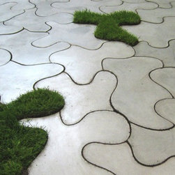Puzzle Slabs - Time for some outdoor games. How about mixing it up with these concrete slab puzzle tiles interspersed with grass? They're chic and witty and let you play on the patio.