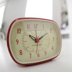 Retro-Style Alarm Clock in Red - Add some retro charm to your bedside table with this fun alarm clock.  It features glow-in-the-dark hands and a beep alarm to make sure you get to the office on time.