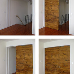 Sliding Barn Door - Custom door fabricated from reclaimed wood. Split door allows flexibility and varying degrees of privacy.