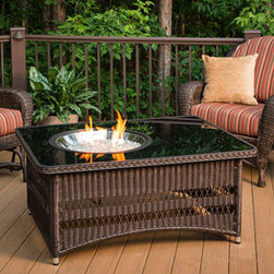 Naples Fire Pit Table with Black Glass Top and Crystal Fire - The modern elements of a gel fireplace and the simple beauty of a basic weave create a perfect balance for the Naples Fire Pit Table with Black Glass Top and Crystal Fire. -Mantels Direct