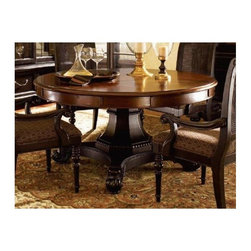 Tommy Bahama Home - Bonaire Round Dining Table - This dining table goes well in any formal dining area or casual eat-in kitchen and has a stylish design with nail head trim and pedestal base. The round top is spacious enough to accommodate dinner guests while also providing a cozy place for family dinners. True Bottom of apron to floor 25.5 in.. Extends another 20 in. diameter. Five 10 in. perimeter leaves. Cassiss finish top and Tamarind finish base. Nail head decorative trims. Made from mahogany solids, American maple and mahogany veneers. Tamarind - black, highly distressed finish. Minimal assembly required. 60 in. Diameter x 30 in. H (355 lbs.). Special Care Instructions from Lexington FurnitureKingstown is a relaxed traditional collection inspired by British Colonial style, with a hint of Campaign and a touch of safari. The Tamarind finish is a rich aged black with rub-through to crimson and gold undertones beneath. The evocative designs provide a sense of a well-traveled life.of items hand selected during journeys around the globe. Each piece is crafted as a one-of-a-kind find yet the eclectic collection coordinates beautifully. Travel the world without ever leaving home.