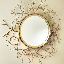 Twig Mirror - Brass - Radiant golden twigs in a network of woodland forms and troubled lines add texture to this round beveled mirror, increasing the glamor of your wall and the sensuous serenity of your space.  The Twig Mirror in Brass is a lovely alternative to the traditional sunburst, offering the same eye-catching, expansive properties along with a delicate, forested feel.