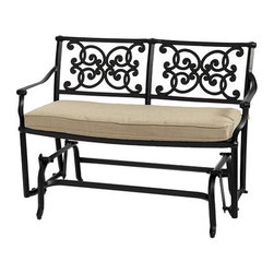 Ballard Designs - Amalfi Glider - Coordinates with our Amalfi Outdoor Collection. Basic tan cushion included. Sand black finish resists rust and chipping. Extremely strong, yet light enough for easy placement. Assembly required. Since each piece in the inviting Amalfi Collection is crafted of cast aluminum, the decoration can be more ornate and finely detailed. Seat features an intricate basket weave design with a rich 3-dimensional look. Seat back is beautifully scrolled on both sides, so you can enjoy the pattern from behind. And because cast aluminum is extremely strong and much lighter than it looks, pieces place easily and yet feel reassuringly sturdy. Amalfi Glider features: . . . . . Replacement cushions available. Requires 1 replacement bench cushion set per glider. Use of an outdoor furniture cover is recommended to extend the life of your piece.