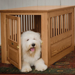 Hand-Crafted Ash Dog Crate - There is nothing worse than a big, bulky metal crate. This wooden one with a cute doggy door works with the decor in your home and isn't an eyesore in your living room.